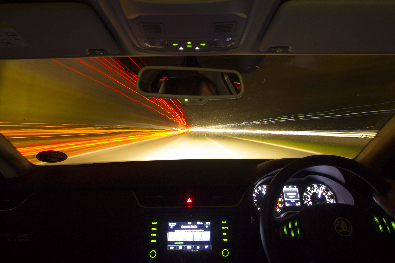 A car driving fast at night