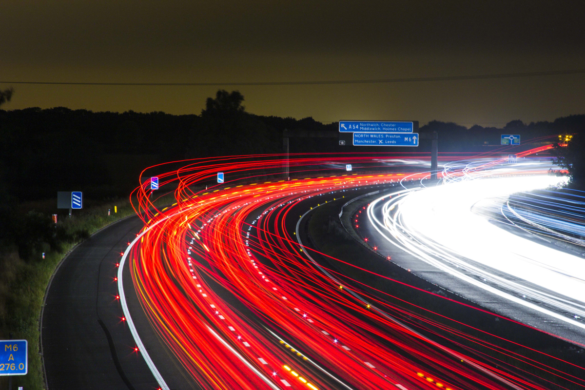 A time lapse of a motorway at night with light trails visible
